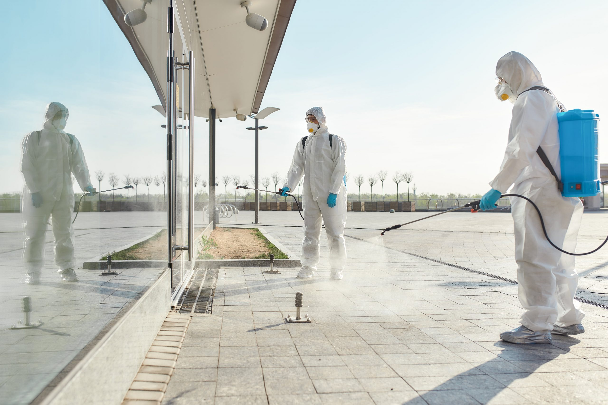 Extreme Cleaning Solutions. Sanitization, cleaning and disinfection of the city due to the emergence of the Covid19 virus. Specialized team in protective suits and masks at work